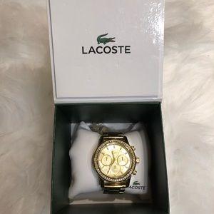 Women's gold Lacoste watch